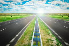 Road stretches into distance. Stock Photos