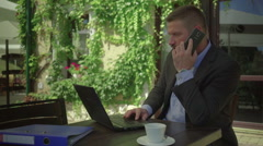Businessman talking by phone, tilt shot, steadicam Stock Footage