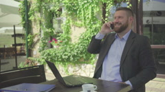 Happy businessman talking by smartphone, steadicam Stock Footage