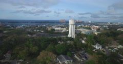 Aerial flyby of water tower towards Nassau resorts Stock Footage