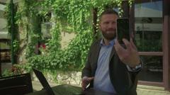 Businessman takes selfie by smartphone, steadicam Stock Footage