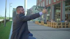 Businessman takes selfie by smartphone. Stock Footage
