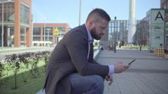 Businessman browsing smarphone, steadicam Stock Footage