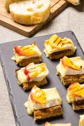 Canapes with grilled brie and nectarine Stock Photos
