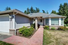 American one level house exterior with garage and tile walkway. Northwest, US Stock Photos