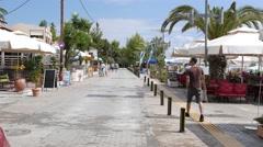 Greece Halkidiki - Nikiti town resort on Aegean Sea - walking along embankment Stock Footage