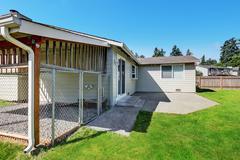 Backyard garden with cage. American Rambler house exterior. Northwest, USA Stock Photos