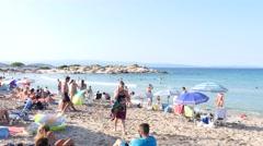 Greece Halkidiki sand beach resort on Aegean Sea - people rest swim and sunbath Stock Footage