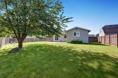 Grass filled Backyard garden of American Rambler house. Northwest, USA Stock Photos