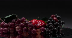Cluster of Grapes that are Fake Rotating on Mirror on Black, 4K Stock Footage