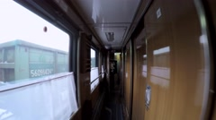 Passing through the sleeping car of a passenger train. Arkistovideo