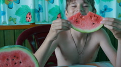 A child eats a slice of watermelon Stock Footage
