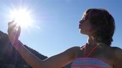 Woman on Greece sea resort shoot take smart phone selfie photo for social media Stock Footage