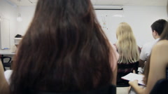 Group of business people listening to a presentation at a business seminar Stock Footage