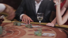 Playing blackjack in the casino. The people at the table are betting - stock footage