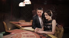 Pair Placing Their Bets on the Blackjack Table in the Casino - stock footage