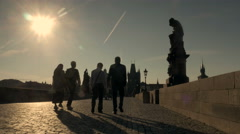 Silhouette shot of tourists crossing the Charles Bridge Stock Footage