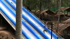 People jump in pool in attraction Slip N Fly . Island Koh Phangan, Thailand Stock Footage