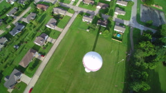 Ascent above small town water tower Stock Footage