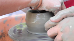 Potter teaches his craft to the children. Pottery class workshop. Clay shaping Stock Footage