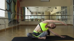 Women is doing pilates stretching exercises in gym Stock Footage