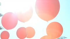 Bright red balloons in the sun. Slow motion. Stock Footage