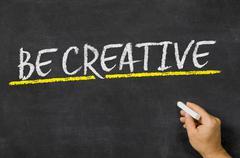Be creative written on a blackboard Stock Photos