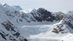 Passing Glacial Cirque and Glacier Icefall in Alpine Alaska Aerial Stock Footage