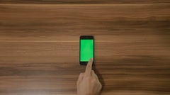 Smartphone Swipe hand gesture on the Background of Wooden Table.Vertical Stock Footage