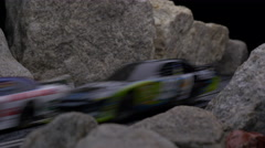 SLOT CARS RACE THROUGH THE MOUNTAINS Stock Footage