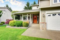 Curb appeal. American house exterior with double garage, concrete floor porch Stock Photos