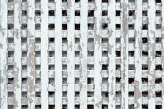 Worn out wooden lattice fence background Stock Photos