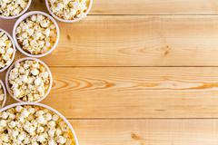 Movies background with popcorn bowls on table Kuvituskuvat