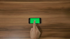 Smartphone Double tap hand gesture on the Background of Wooden Table.Horizontal Stock Footage