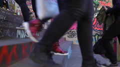 Many feet kicking up and down the stairs with graffiti. Time Lapse. Stock Footage