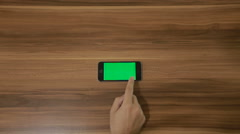 Smartphone Swipe Right hand gesture on the Background of Wooden Table.Horizontal Stock Footage