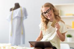 Girl holding tablet and credit card Stock Photos