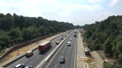 Traffic passing through roadworks on the M3 in Hampshire Stock Footage