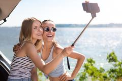 Cheerful friends making selfies Kuvituskuvat