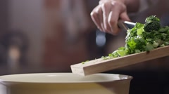 Making of salad with fresh herbs and broccoli. Slow Motion. Stock Footage