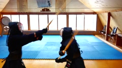 A furious duel of two outstanding men of the ancient Japanese art of kendo. Stock Footage