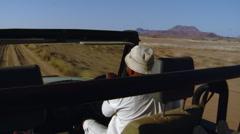 Safari Jeep Driving Through Namib Desert Stock Footage