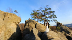 Romantic fairytale couple newlyweds posing at sunset on a background  Stock Footage