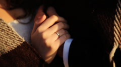 Bride and groom holding hands with wedding rings, outdoors Stock Footage