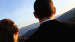 Newlywed couple holding each other. Mountain landscape as backround.  Stock Footage