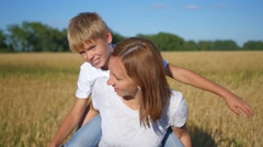Happy people having fun in wheat field Stock Footage