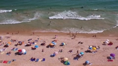 People in beach landscape - Albufeira ALGARVE Stock Footage