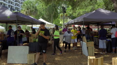 People shopping at Farmers market in Downtown Orlando Stock Footage