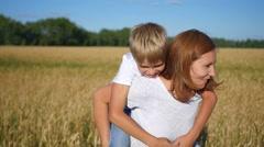 Happy people having fun in wheat field Stock Footage