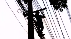 Silhouette Electrician wiring Newly on Pole  Stock Footage